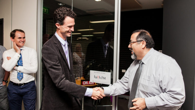 Faith FM coordinator Michael Engelbrecht and AUC president Pastor Jorge Munoz, after cutting the ribbon to open the new studio.  Photo: Adventist News Online