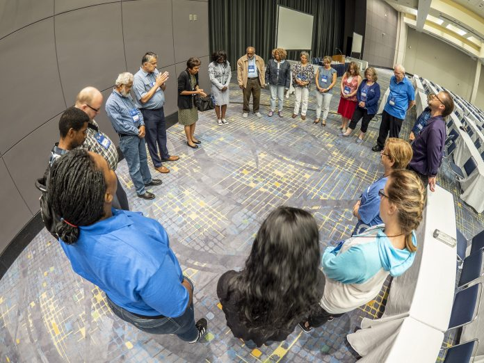 Before the anointing service at the NAD Teachers' Convention, a group of teachers gathered at 6:00 a.m. to pray for participants of the special service. [Photo: Dan Weber, North American Division News]