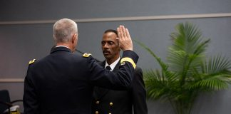 Lt. General Reynold Hoover administers the oath of office to Washington Johnson II as part of Johnson's promotion ceremony at the North American Division regional headquarters on October 8, 2018. [Photo: Mylon Medley, North American Division News]