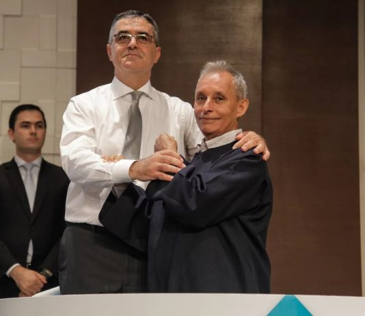 Electrical engineer Ivon Antônio de Souza (right) was baptized on December 8, 2018, in a hall at the South American Division (SAD) church headquarters that he had helped to build eight years earlier. [Photo: South American Division News]