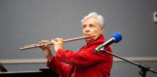 Lilya Wagner, director of Philanthropic Services for Institutions (PSI), plays her flute for the worship service on National Philanthropy Awareness Day, November 14, 2018, at the North American Division headquarters. [Photo: Mylon Medley, North American Division News]