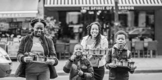 """Adventist youth and children performed """"random acts of kindness"""" for people on the streets of two London, United Kingdom, neighborhoods on March 16, 2019. Activities were part of the ongoing I AM URBAN initiative, a partnership between the UK Adventist Development and Relief Agency (ADRA) office and the UK branch of Adventist Community Services (ACS). [Photo: ADRA United Kingdom]"""