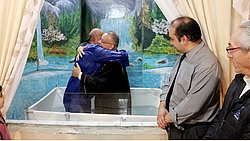 """Man is baptized after finding DVD """"The Great Conflict"""" in the garbage"""