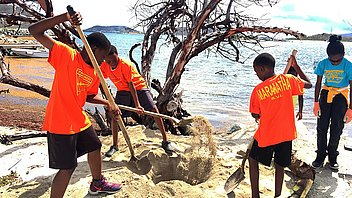 Adventists plant dozens of coconut trees to beautify beach shores on Tortola