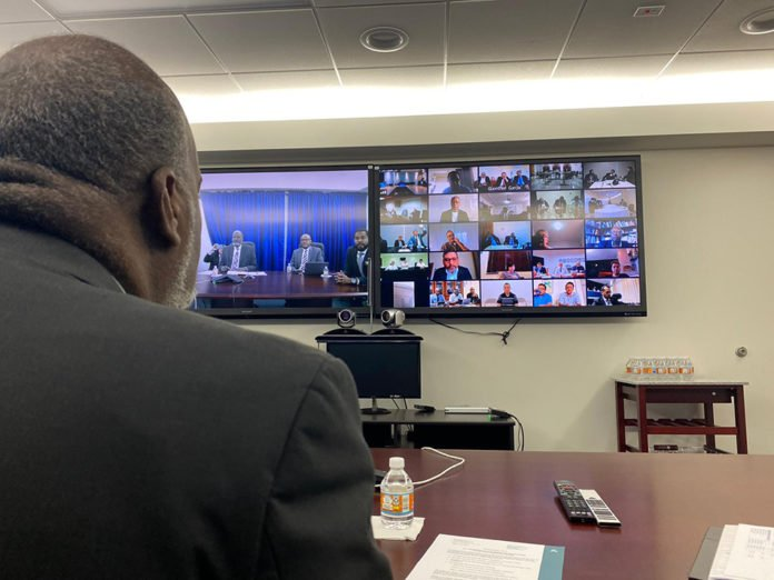 Inter-American Division president Elie Henry (left) is joined by fellow administrators in Miami, during videoconference meetings with the 24 union administrators. [Photo: Abel Márquez, Inter-American Division News]