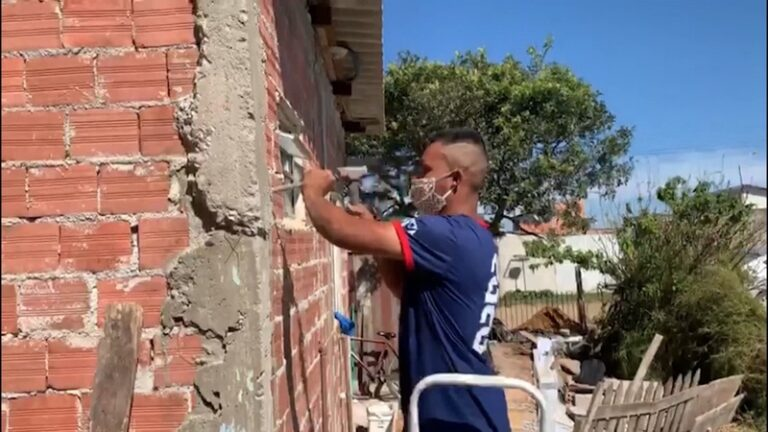 Volunteers build a residence for an unemployed couple